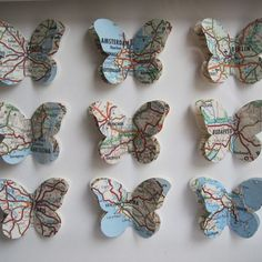 map butterflies DIY inspiration -- cut out butterflies from a map of the places you've visited, mount and frame for a unique memento of your trip.