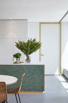 Green decor is at the forefront in these gorgeous spaces. Whether it's green tile in the kitchen or a bold green couch, this colour is a design win!
