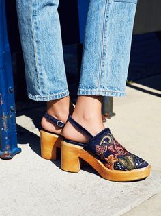 Cosmic Storm Clog | Ultra femme clog featuring pretty floral embroidery and bead embellishments on the upper. Adjustable thin velvet strap wraps around the heel for a cute and comfortable fit. Supportive footbed for an easy step.
