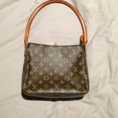 "Louis Vuitton looping bag Authentic Louis Vuitton Looping Bag. Measures 9x9 with 8.5"" drop. There are some ink marks on the bottom inside. Louis Vuitton Bags"