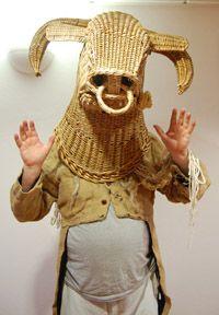 Irish mummer in a bull mask.