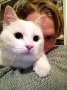 John Klingberg hugging his cat, Lex