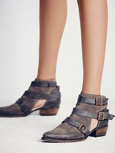 Jade Ankle Boot | Pointy toe leather booties featuring contrast strap detailing with buckle accents.  Side cutout detailing and a stacked wooden heel.   *Freebird by Steven + Free People