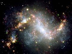 Topsy-Turvy Galaxy, NGC 1313, is a barred spiral galaxy. It has a strikingly uneven shape and it's axis of rotation is not exactly in its center. A starburst galaxy. Constellation Reticulum