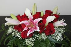 Pink centered oriental lily and red rose headtable arragement.
