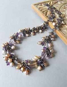 The  Turning Wisteria necklace - lush and decadent, this is absolutely laden with freshwater pearls and delicious gems!