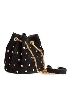 Small bucket bag in suede with round studs, a metal chain shoulder strap, and snap fastener. Fabric lining. Diameter 5 in., height 6 in.H&M Bucketväska i Party-Perfect Bags That Will Hold More Than Just a Lipstick H&m Fashion, Fashion Bags, Suede Handbags, Purses And Handbags, Potli Bags, Stylish Handbags, Boho Bags, Chain Shoulder Bag, Shoulder Strap