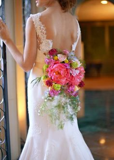 Go beyond the traditional bouquet and adorn your dress with beautiful blooms like these from Lush Couture Floral. Photo by J.May Photography. Gown from Bridal Boutique. #wedding #florals #whimsical