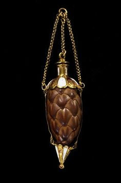 Scent flask made from a pine cone mounted in enamelled gold. Spain, ca 1600