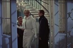 Despite the coat made of fur, this outfit is purrrrfection! Doris Day Movie Fashion Style: Pillow Talk.