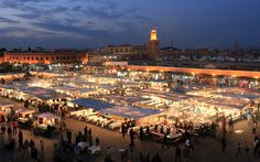 Djemma el-fna - Marrakech - Morocco.   Story tellers, henna tatooing, freshly squeezed juice and local dentistry by day - amazing food stalls by night. Wonderful atmosphere, great food, a must!