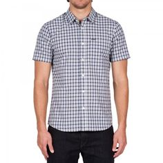 Woven shirt's plaid print is destined to keep your style in check.Features:Short sleeve shirt features a modern fit that wears slightly slimMade from a premium cotton fabricStyled with a patch chest pocket and our new basic b
