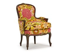 The Orleans Chair is a fine example of a Louis XV decorative bergère featuring closed arms and fine carving details.