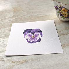 Print of a dark purple pansy by watercolour artist Kathleen Maunder, trowelandpaintbrush