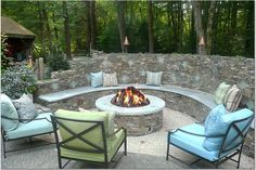 We love how the blue cushions pick up the blue tiles in the stone wall. And that's a beautiful fire pit, too. Designed by Boston's Leslie Saul and Associates (@lesliesaulassoc)