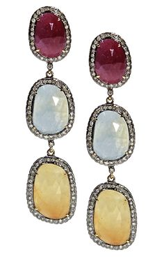 These stunning sapphire earrings are set in 14k yellow gold with three oval sapphires for a vibrant display of color.