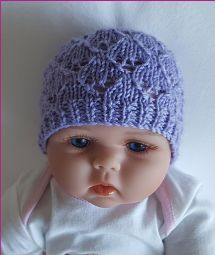 Baby beanie knitting pattern worked in a lovely lace stitch.