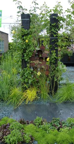 Recycled cans made into insect and bee hotels at the Chelsea Flower Show