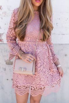 Lovely pink lace dress worn on fashion blogger. Perfect dress to wear to a wedding, event, or party.