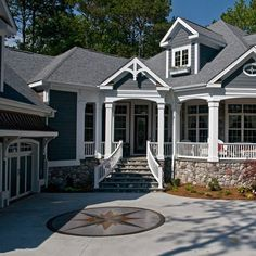 Gray Siding with Stone Skirting by home sweet home