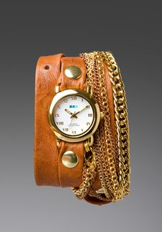 Brown Leather, Gold Chains, & a watch
