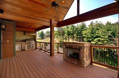 outdoor covered high deck with fireplace | Reynolds Mountain Homes for Sale | Asheville NC