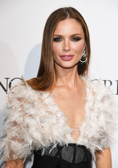 Feathered fancy: Actress and fashion designer Georgina Chapman oozed sophistication in a c...