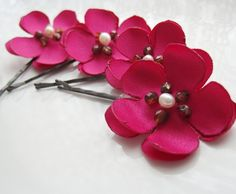 See shop announcement for current production to ship time.    Five sweet cherry blossoms make beautiful and unique adornments. The fabric is a rich matte satin in fuschia. Center beads are single freshwater pearls surrounded by faceted czech glass in tortoiseshell colors. Flowers are completely hand crafted.    Sizes are at random and vary from approximately 1.25 diameter to 1.75. The set shown has brunette toned pins. If you would like blonde or black pins, or a different number of pins…
