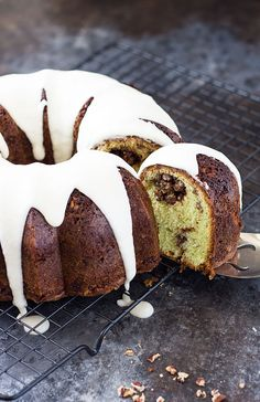 Pistachio Sock-It-To-Me Cake - A pistachio bundt cake with a nutty center and drizzled with vanilla butter glaze. Pistachio Dessert, Pistachio Pudding, Sock It To Me Cake Recipe, Cupcake Frosting, Cupcakes, What To Cook, Cakes And More, Coffee Cake, Cooker Recipes