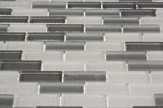 EMPIRE 1/2X2 GLASS TILES    These beautiful mosaics in polished and frosted glass in gray and white is a stunning design. These tiles are mesh mounted and will bring a sleek and contemporary design to any room. The mesh backing not only simplifies installation, it also allows the tiles to be separated which adds to their design flexibility.