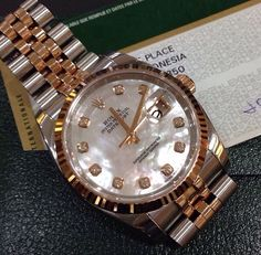 Rolex DateJust in two toned and mother of pearl dial.