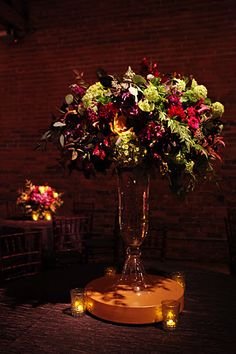 Tall Centerpiece for Fall Wedding Reception-can be modified of course. This is a more natural shaped centerpiece going with the nature themed vision