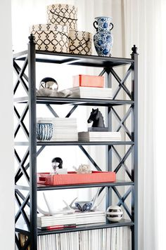 Styling - use trays to contain items as part of a bookcase vignette