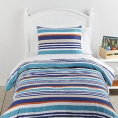Over the Line Bedding Set | Crisp, cool, and just a little bit beach, this striped comforter set turns the volume up on a timeless print option.