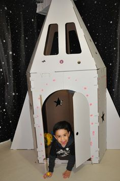 Cardboard spaceship. Could have kids decorate it as an activity.