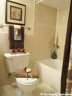 beautiful bathroom decorating and home staging with orchids beautiful orange candles and towels - Staging A Bathroom