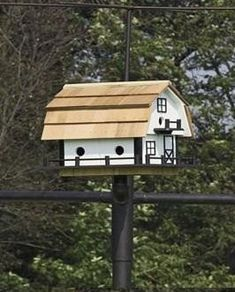 "Barn-Style Martin Bird House with Six Compartments from DutchCrafters Amish Furniture. Built to resemble an Amish barn, this 6 compartment birdhouse for Martins is made from wood, available in 6 painted colorways, and features 6 ""apartment-like"" compartments. #birdhouse #backyard #painted #wooden"