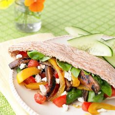 Perfect for outdoor dining, these pitas filled with grilled vegetables and tangy feta cheese make for easy no-utensil noshing.