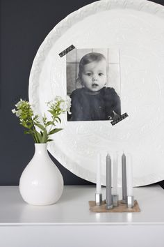 simple contemporary display using white ceramics - great idea using Washi tape to hold a black & white photo