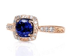 Love the rose gold!!14K Rose Gold Art Nouveau Blue Sapphire Engagement Ring Diamond Halo Blue Sapphire Ring Vintage Custom Bridal Jewelry. $1,135.00, via Etsy.