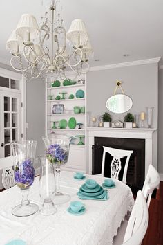 Gray doesn't have to be sterile. A collection of blue and green dishware pops against the cool grays and whites of this space.