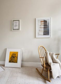 framed art on white wall with chair and throw blanket via sfgirlbybay | white washed wooden floors | vintage rocking chair with a knitted throw