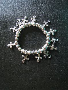 Cross Stretch Bracelet by MoseyRoseDesigns, via Etsy.