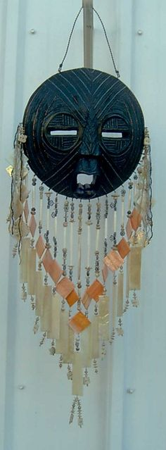 African Mask wind chime....I would want it with a smile & maybe Yellow on top  ;)