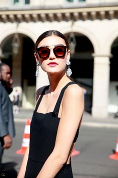 Sunglasses + statement crystal earrings