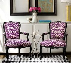 Pair of black Louis XV chairs in contrasting Madeline Weinrib's Purple Luce