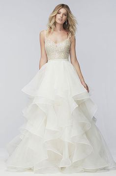 A beautiful ball gown with tiered organza skirt and beaded bodice. WTOO's Spring 2016 wedding dress collection.