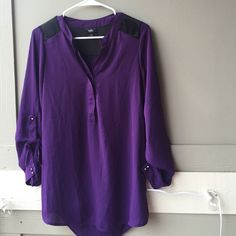 Cute Purple Blouse I'm selling a purple/black blouse. The back opens up when you wear it. (I can try it on if you want) it's never been worn besides trying it on. Black on the back & shoulders. It's wrinkly because its been in my closet for a long time Mossimo Black Tops Blouses