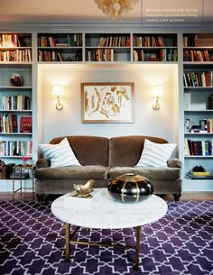 Not a fan of the mixed prints or brown couch... BUT I love the layout of the bookshelf wall and the nook for the couch.