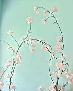 We've talked about using paper decorations to punch up a last minute party, but there are ways that you can incorporate paper into your everyday décor as well. My favorite paper creations of late are tissue paper cherry blossoms, which are as pretty as they are easy to make.